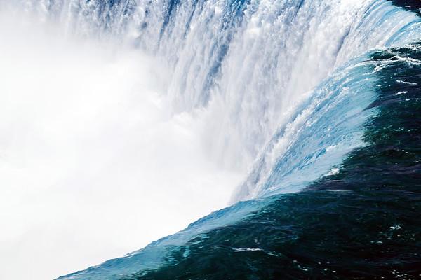 Water flowing over the Horseshoe Falls in Niagara Falls
