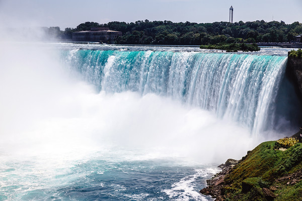 Water flowing over the falls in Niagara Falls