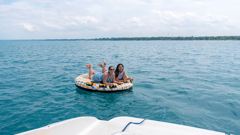 Boat ride in Grand Bend, Ontario on a little raft behind the speedboat.