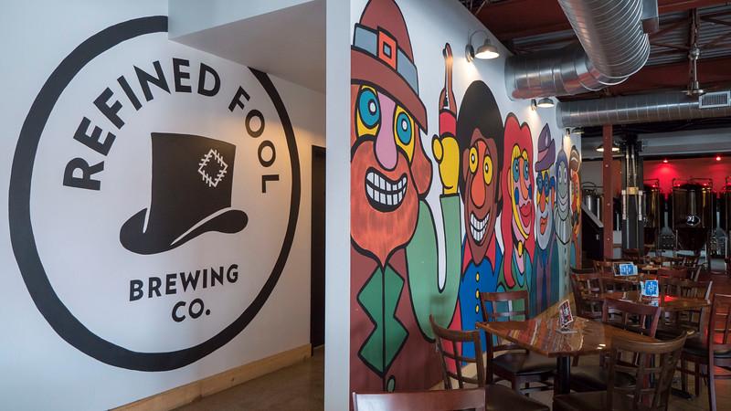 Refined Fool Brewing Co in Sarnia, Ontario, Canada. Colourful wall mural in the midtown brewery.