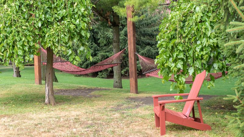 Hammocks and Muskoka chairs at Oakwood Resort in Grand Bend, Ontario, Canada.
