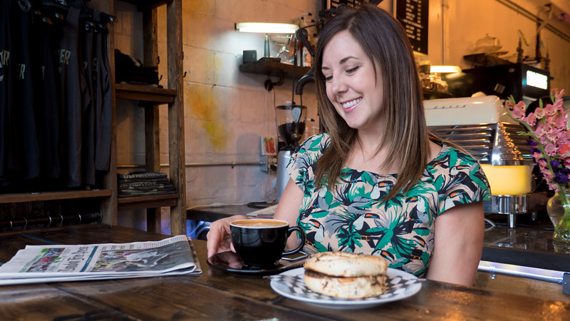 Lauren enjoying a cup of coffee and bagel at Blackwater Coffee Co in Sarnia, Ontario.