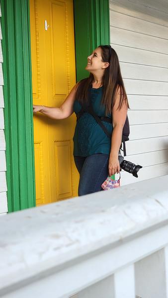 Lauren entering a door