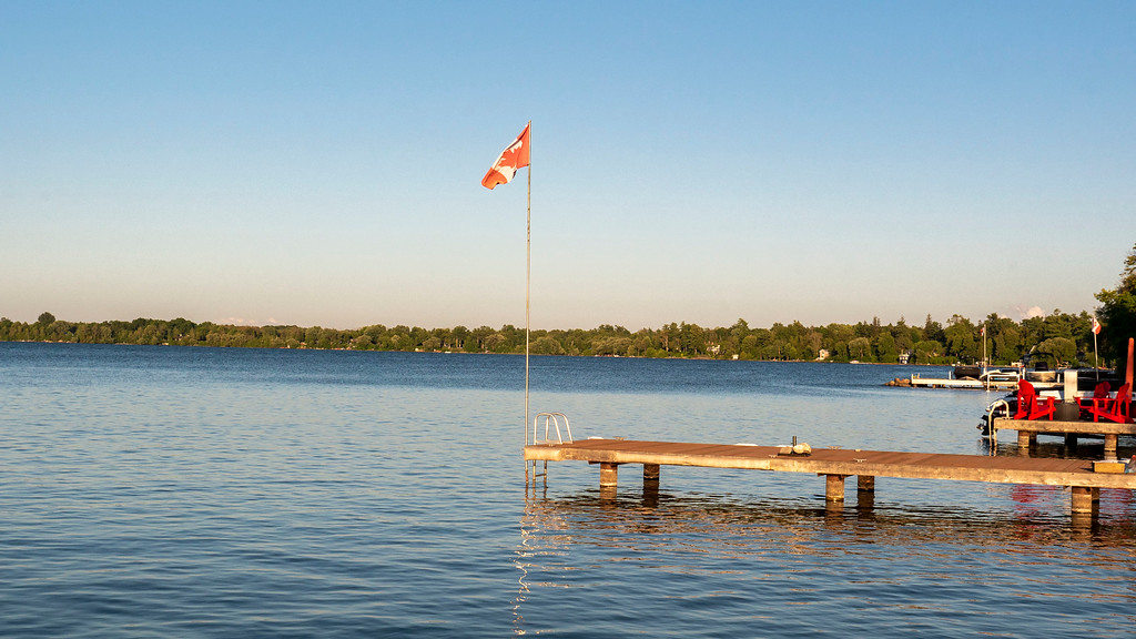 Canadian flag at end of dock on Lake Simcoe