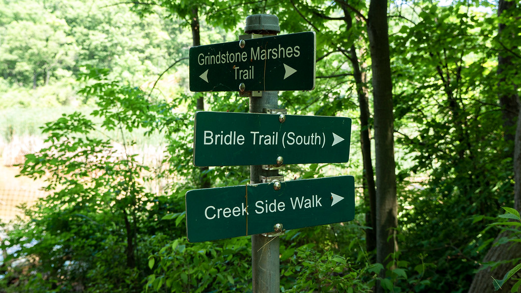 Signs posted on the Royal Botanical Gardens trails in Hendrie Valley