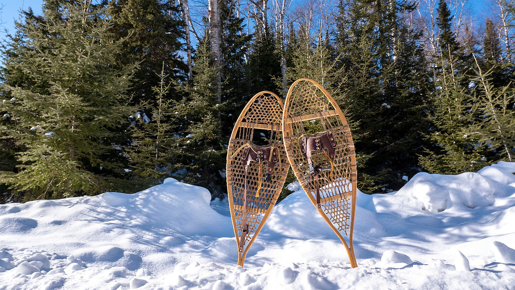 Wooden snowshoes in the snow