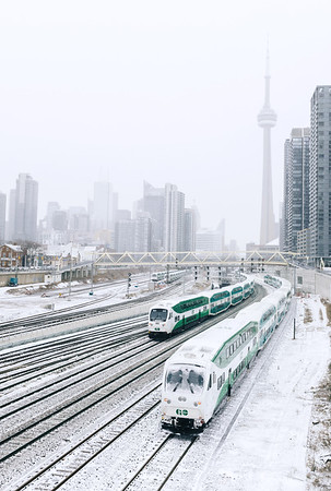 Trains in downtown Toronto on a snowy day.