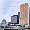 Go Train in passing in front of the Fairmont Royal York and the Toronto's Financial District.
