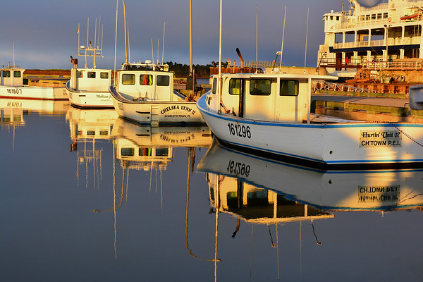 Reflecting boats at Wood Island Ferry