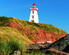 Souris Lighthouse and rocks and grass