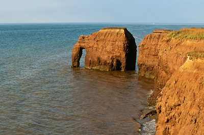 Elephant Rock is the name given to an unusual rock formation on the shores near Seacow Pond in Western Prince Edward Island. The rock, carved from the red sand-store cliffs by the waves had the rough shape of an elephant, complete with tusk. Unfortunately, in the winter of 1999, much of Elephant Rock was destroyed by ice and erosion.