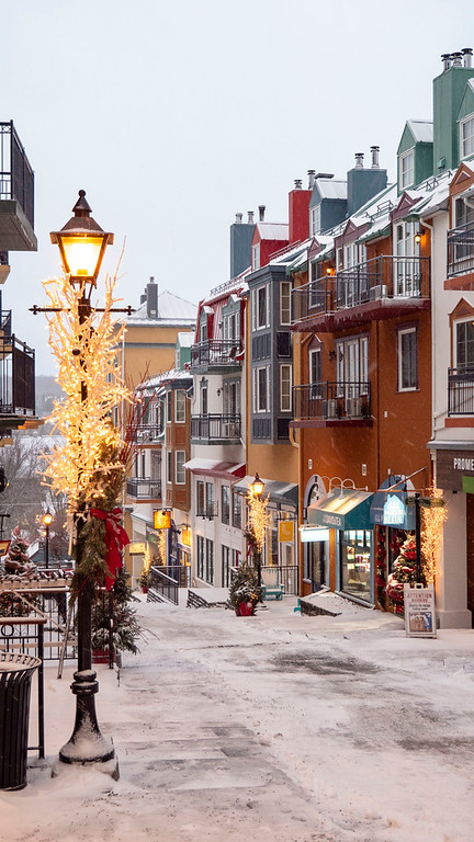 Mont Tremblant pedestrian village in the winter - Snowy Tremblant village - Winter in Quebec, Canada
