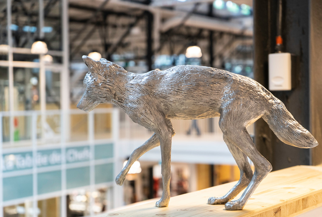 One of ten silver wolf statues found at Le Grand Marché in Quebec City.