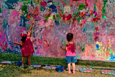 Two Children Fingerpainting in a Public Park