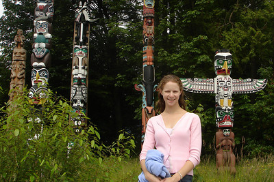 Emily and some of the totem poles of Stanley Park - Vancouver, BC ... June 23, 2007 ... Photo by Rob Page III
