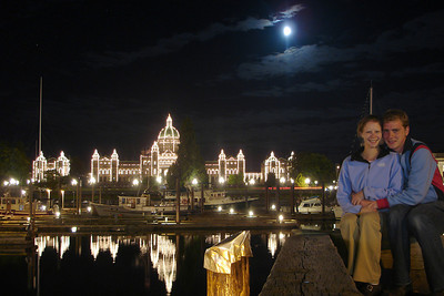 Emily and Rob with the British Columbia Parliament Building at night - Victoria, BC ... June 25, 2007 ... Photo by Rob Page III