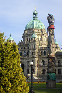 The British Columbia Parliament Building with a totem pole in front - Victoria, BC ... June 25, 2007 ... Photo by Rob Page III