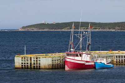 Rocky Harbour in Gros Morne National Park, with Lobster Cove Head Lighthouse in the background.