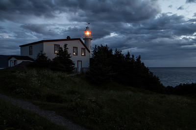 Lobster Cove Head Lighthouse just after sunset when the light turns on.