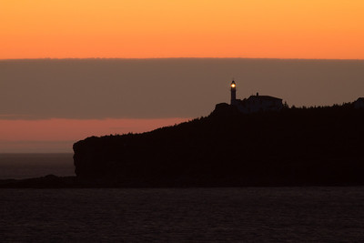 Lobster Cove Head Lighthouse from Rocky Harbour in the evening.