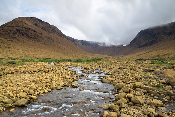 The Tablelands in Gros Morne National Park, where eons ago two continents collided, forcing rock from miles below the surface up on top of the Earth's crust.  The rock is toxic to most plant life and hence, is somewhat desert-like.