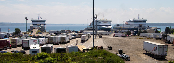"All three Newfoundland ferries in Nova Scotia at once. From left to right, the ""Blue Puttees"", the ""Atlantic Vision"" and the ""Highlanders"". The trucks and cars at left are waiting to board the ""Highlanders""."