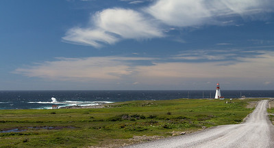 Waves and lighthouse at Port au Choix.