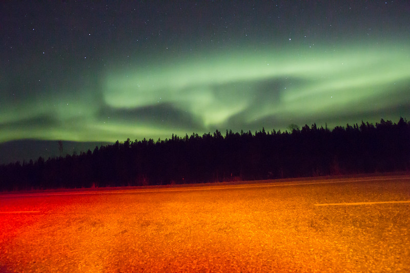 Aurora Borealis - Yukon Territory,  Canada<br /> Tail lights from the car colored the foreground.