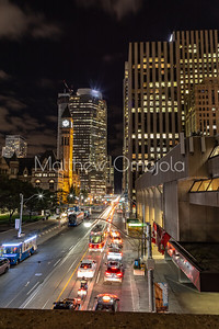 Queen Street West Toronto Ontario at night. Old City Hall Tower Clock ahead on the left . Sheraton Hotel on the right.