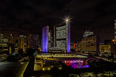 Toronto Ontario Canada City Hall at night with surrounding hospitality district.