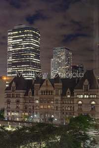 Old City Hall now Courthouse Toronto Downtown at nigh with surrounding high rise buildings
