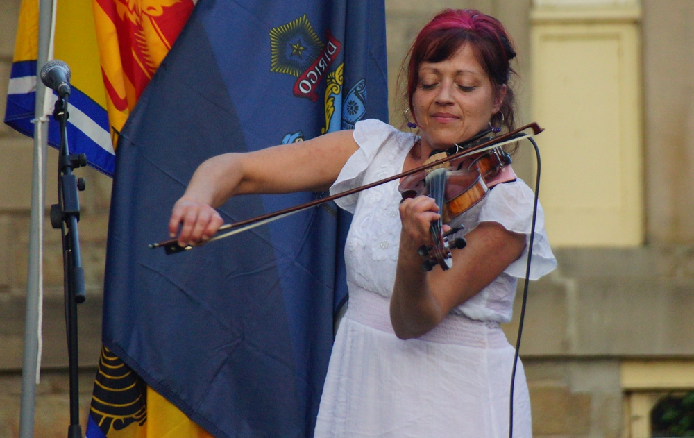 This is a shot of a talented French Acadian violinist performing at the New Brunswick Highland Games in Fredericton, Canada