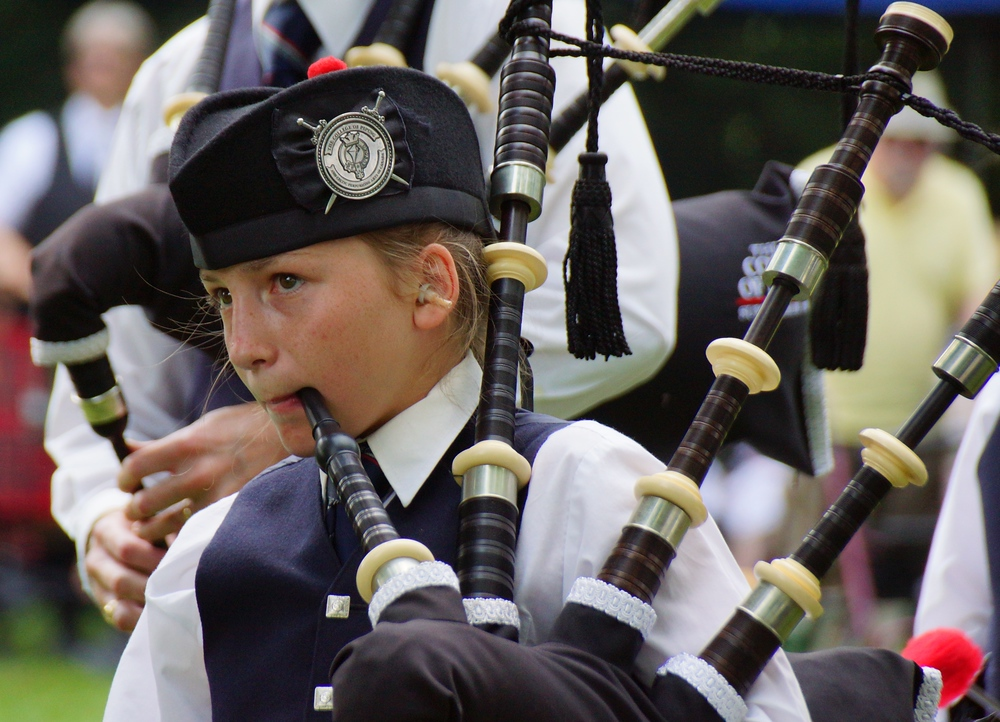 A girl plays the bagpipe at the New Brunswick Games in Fredericton, Canada