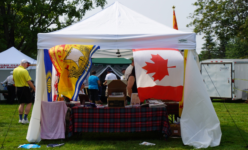The New Brunswick Provincial flag and the Canadian National Flag at the Fredericton Highland Games