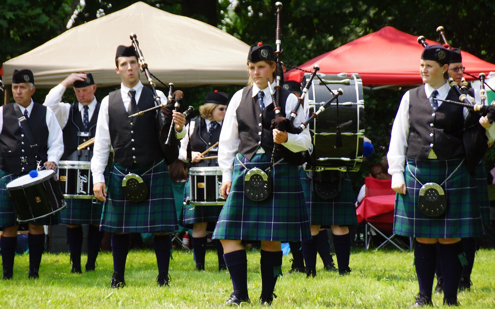 A band of bagpipers taking a rest before playing at the Highland Games in Fredericton, New Brunswick, Canada