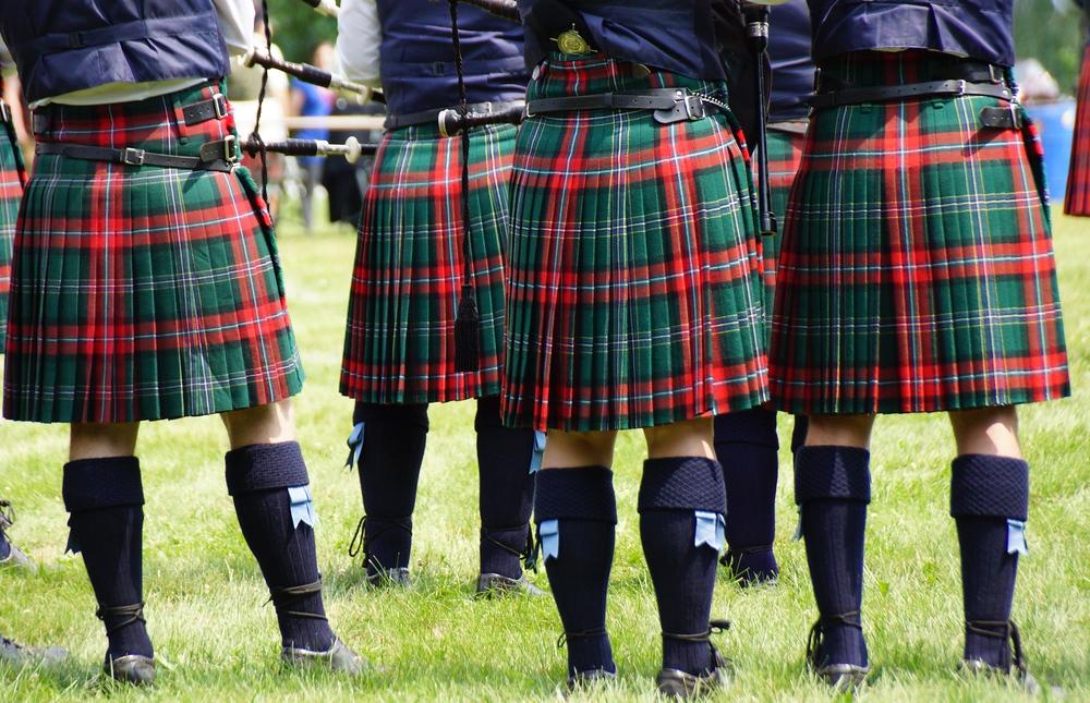 A group shot of men wearing kilts at the New Brunswick Highland Games
