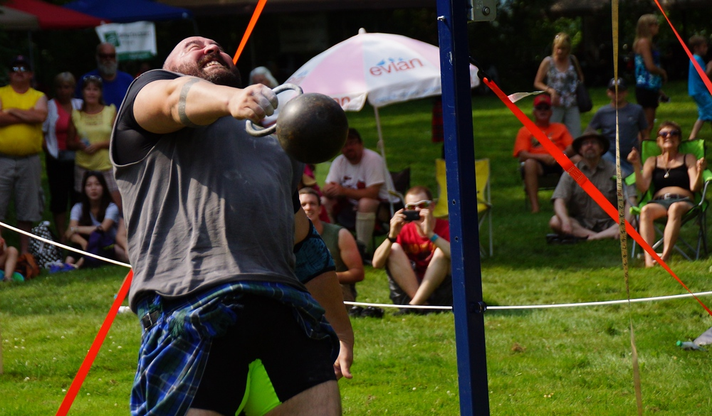 A mountain of a man prior to releasing the weight over his head at the Highland Games in Fredericton, New Brunswick, Canada