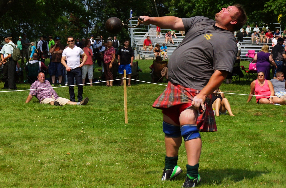 A perspective shot of a man training for the weight over height event at the Highland Games
