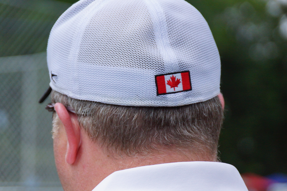 A man wearing a hat with a Canadian flag at the New Brunswick Highland Games in Fredericton