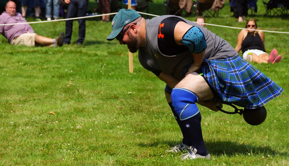 A side angle shot of an athlete warming up for the weight for height event at the New Brunswick Highland Games