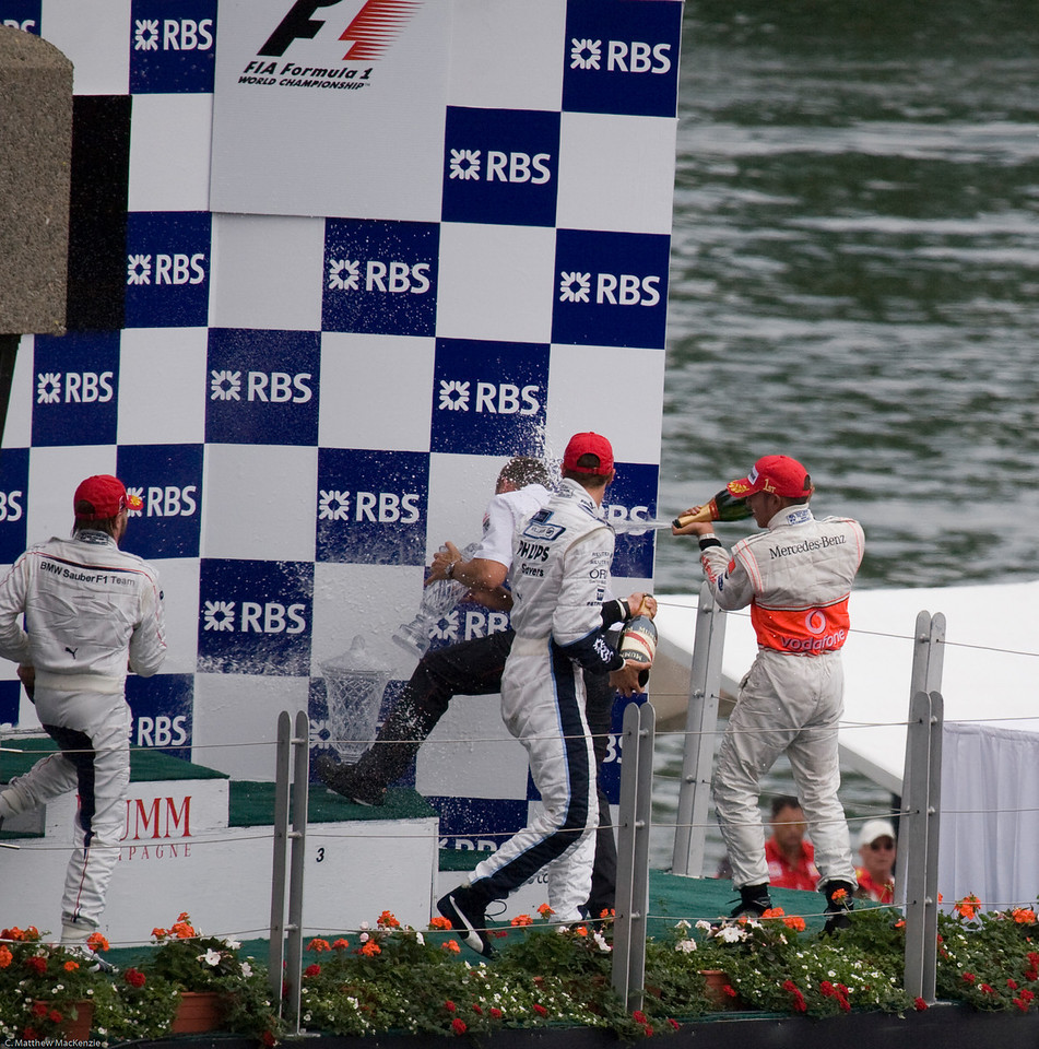 Ron Dennis gets soaked...