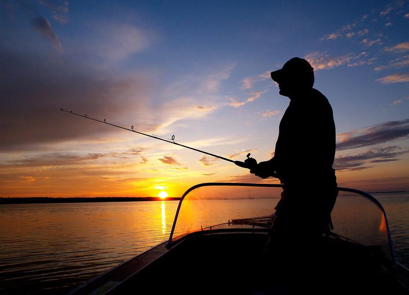 Fishing 'til the light is gone.