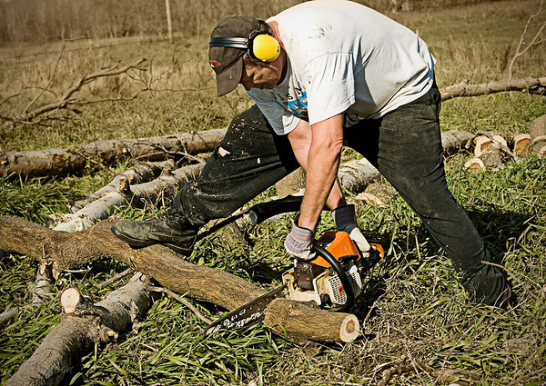 Man at work... Gotta be autumn.... when it's all about cutting wood for the wood stove. Come to think of it - we can say the same thing in the spring! Guess it's year round hard work, just to keep the home fires burning....