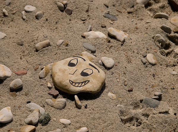 We found quite a few smiles on the beach that day too... so that kind of blew my theory of some sort of Shakespearian tragedy occuring right there on that little beach.... Cute rocks, but I definitely preferred the ones with the poignant poetry !