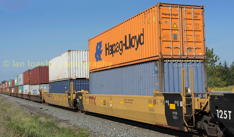Double stacked containers is the normal. some containers in Canada are now 53ft long