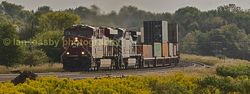 CP Bellleville Sub near Lovekin  at approx mile 287,   east tof Toronto  CP's Gevo powered ES44AC  8945  along with CEFX (a leasing company) 1104  head a Montreal - Vancouver  intermodel via Toronto westbound