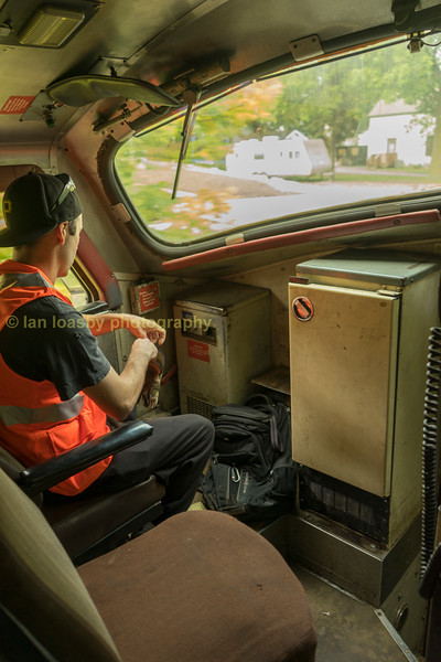 Two crew sets in the cab along with a fridge