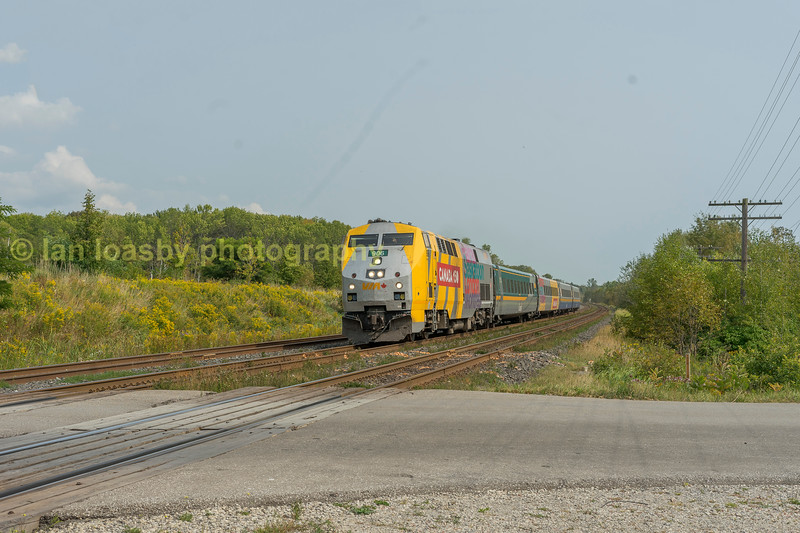 Via rail train 45 the daily 1030-Ottawa- Toronto train passes at speed west of Grafton on the CN Kingston sub fri-15-09-17.