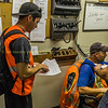 My crew being briefed priior to departure, note the printed train orders and radios being charged