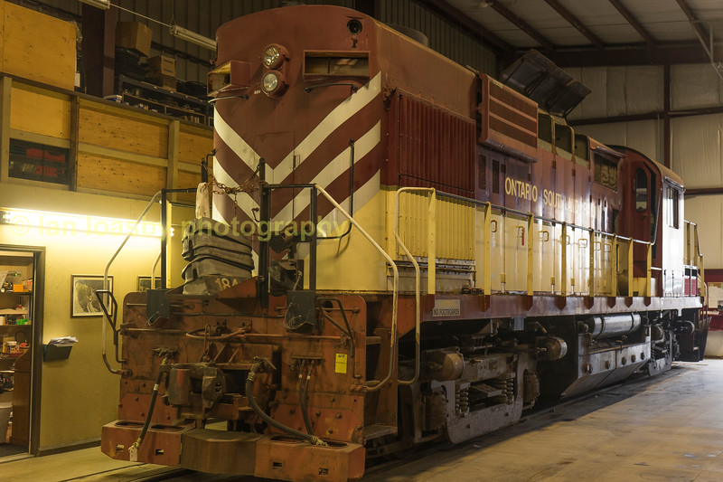 An unidentified OSR GP9 sits at the back of the shop.
